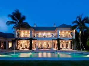 Palm-Beach-Mansion-at-night-with-pool-fountains